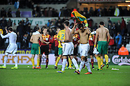 A dissappointed Swansea City Captain Neil Taylor walks off the field at full time.<br /> UEFA Europa league match, Swansea city v FC Kuban Krasnodar at the Liberty Stadium in Swansea, South Wales on Thursday 24th October 2013. pic by Phil Rees, Andrew Orchard sports photography,