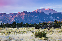 Sunset over the Great Sand Dunes National Park and 13,297 ft. Herard Peak of the Sangre De Cristo Mountains, Colorado.