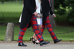 Guests arrive ahead of the wedding of the Duchess of Cambridge's sister Pippa Middleton to her millionaire groom James Matthews, dubbed the society wedding of the year at, St Mark's church in Englefield, Berkshire.