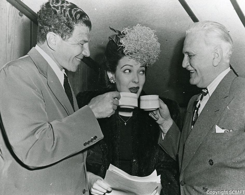 1943 Lionel Stander, Linda Darnell and Frank Morgan share cups of coffee at the Hollywood Canteen.