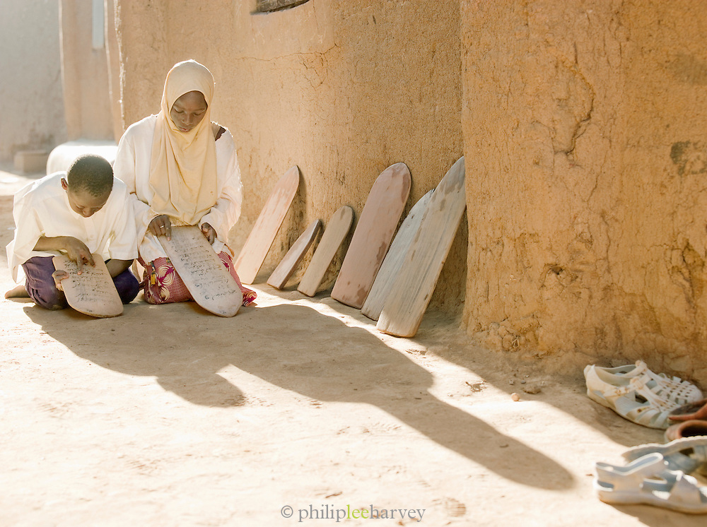 Students from the Koranic school learn scripture from the Koran in Djenné, Mali