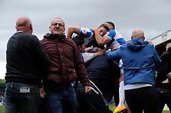 Bristol Rovers' David Clarkson celebrates his goal with team mates as fans invade the pitch - Photo mandatory by-line: Dougie Allward/JMP - Mobile: 07966 386802 26/04/2014 - SPORT - FOOTBALL - High Wycombe - Adams Park - Wycombe Wanderers v Bristol Rovers - Sky Bet League Two