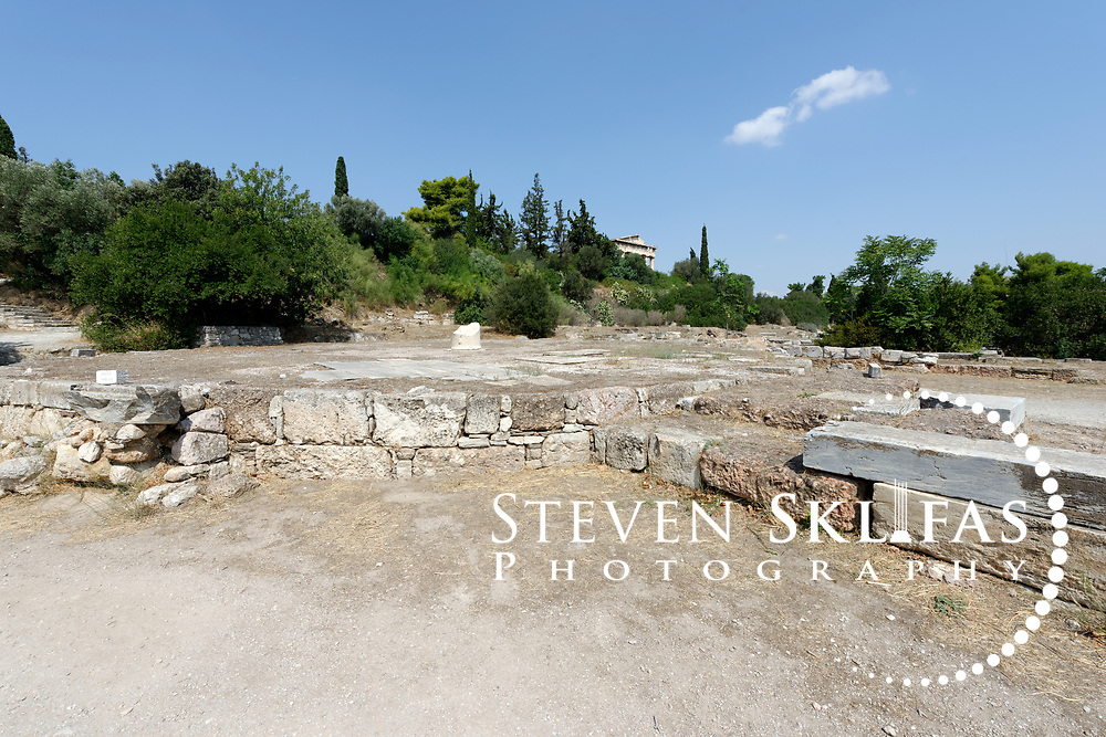 Foundations of the Tholos or Shias. Ancient Agora, Athens. Greece. The Tholos was the headquarters and heart of the ancient Athenian government. Built around 470 BC, the beehive shaped circular building had six interior columns supporting the roof and a Propylon was added in the 1st century AD. The building was the meeting place of the 50 Prytaneis (senators), a third of who were required to be to be in attendance twenty-four hours a day in case of emergencies. Accordingly they were provided with meals and sleeping accommodation in the Tholos. The Agora from 600 BC onwards was the commercial and social centre of Ancient Athens. It was here that laws were written and displayed, commercial goods bought and sold, intellectual discussions were had, and the democratic spirited was born and nurtured.