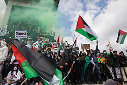 London, UK. 22nd May, 2021. Pro-Palestinian protesters gather around Nelson's column in Trafalgar Square during the National Demonstration for Palestine. It was organised by pro-Palestinian solidarity groups in protest against Israel's recent attacks on Gaza, its incursions at the Al-Aqsa mosque and its attempts to forcibly displace Palestinian families from the Sheikh Jarrah neighbourhood of East Jerusalem.