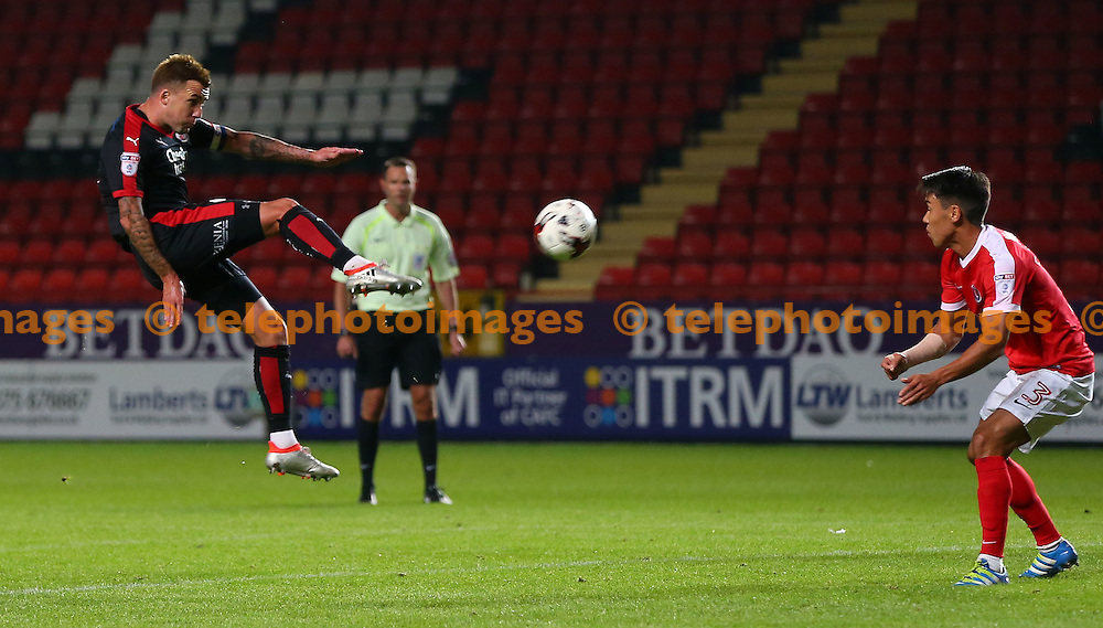 Crawley's Captain Jimmy Smith  shoots during the Checkatrade Trophy match between Charlton Athletic and Crawley Town at The Valley in London. October 4, 2016.<br /> James Boardman / Telephoto Images<br /> +44 7967 642437