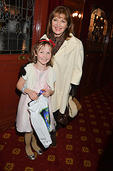 Actress STEPHANIE BEACHAM and IMOGEN SAVILL niece of Hello! editor Rosie Nixon at a VIP evening for the pantomime Aladdin at The New Wimbledon Theatre, The Broadway, Wimbledon, London SW19 on 9th December 2013.
