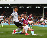 Ryan Fredericks of Fulham tackled by Nathan Baker of Aston Villa during the Sky Bet Championship match at Craven Cottage, London<br /> Picture by Richard Brooks/Focus Images Ltd 07947656233<br /> 17/04/2017