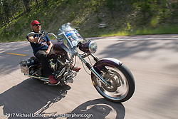 The Mayor of Fun Bean're on the Bean're rides his chopper bagger on Aidan's Ride to raise money for the nonprofit to help raise awareness and find a cure for ALD (Adrenoleukodystrophy) during the annual Sturgis Black Hills Motorcycle Rally. SD, USA. Tuesday August 8, 2017.  Photography ©2017 Michael Lichter.