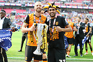 David Meyler of Hull City (l) poses with the Sky Bet Championship Playoff Trophy with Ahmed Elmohamady of Hull City.  Skybet football league Championship play off final match, Hull city v Sheffield Wednesday at Wembley Stadium in London on Saturday 28th May 2016.<br /> pic by John Patrick Fletcher, Andrew Orchard sports photography.