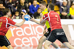 Michal Szyba  of RK Gorenje between Marvin Lier and Marcel Hess  of Winterthur during handball match between RK Gorenje Velenje (SLO) and Pfadi Winterthur (SUI) in Group Phase of EHF European Cup 2014/15, on March 8, 2015 in Rdeca dvorana, Velenje, Slovenia. Photo by Vid Ponikvar / Sportida