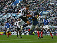 Photo: Andrew Unwin.<br /> Newcastle United v Portsmouth. The Barclays Premiership. 26/11/2006.<br /> Portsmouth's Linvoy Primus (R of C) competes bravely with Newcastle's Steven Taylor (L of C).
