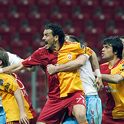 Galatasaray's Servet CETIN (C) and Ayhan AKMAN (2ndL), Gokhan ZAN (R) during their Turkish superleague soccer derby match Galatasaray between Trabzonspor at the TT Arena in Istanbul Turkey on Sunday, 10 April 2011. Photo by TURKPIX