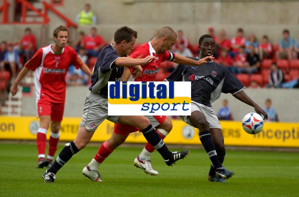 Photo: Richard Lane.<br />Swindon Town v Reading. Pre Season Friendly. 29/07/2006. <br />Swindon's Christian Roberts earns a penalty as he battles through the Reading defence.