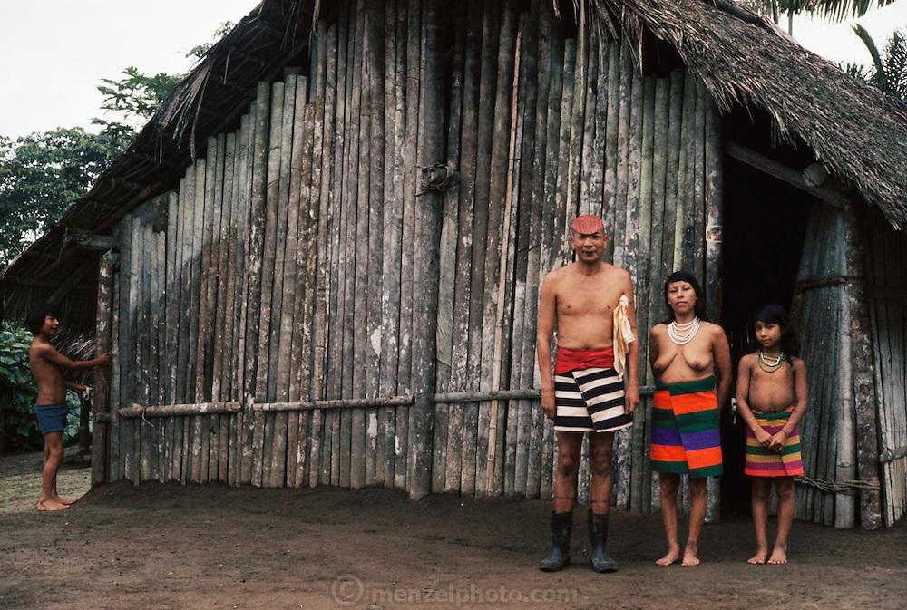 Santo Domingo, Ecuador; Colorado Indian family in front of their house.