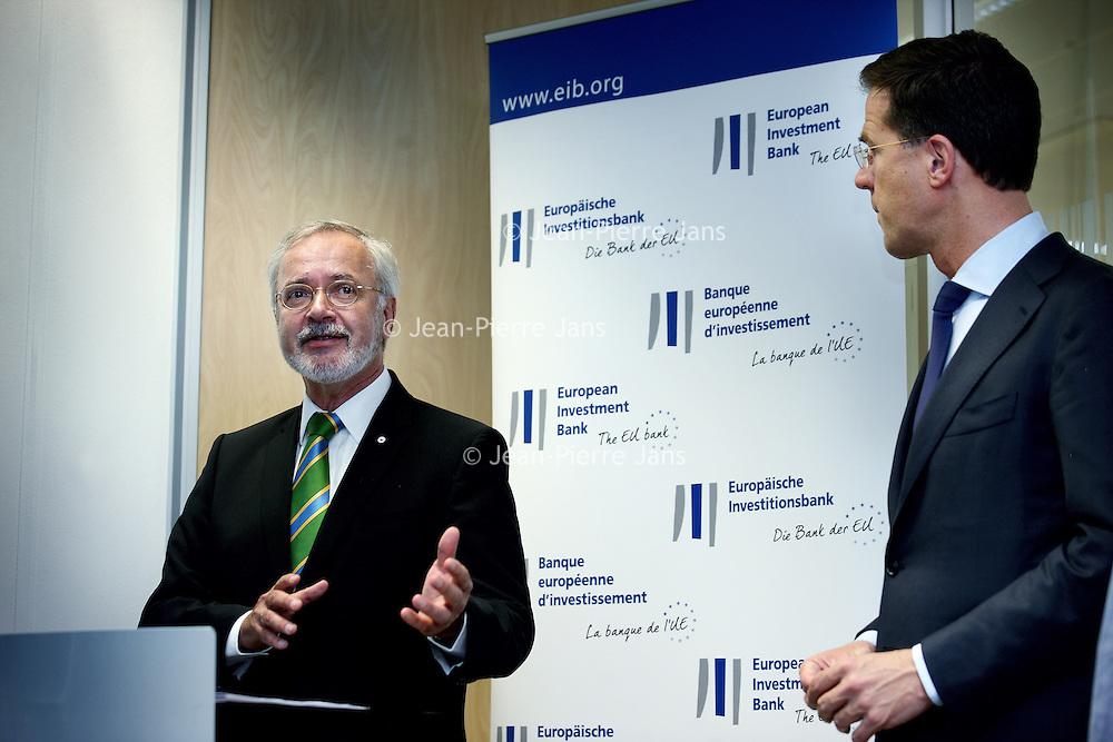 Nederland, Amsterdam , 15 mei 2014. <br /> Minister-president Rutte (m) opende donderdag 15 mei de Nederlandse vestiging van de Europese Investeringsbank (EIB) in Amsterdam. <br /> Werner Hoyer, de president van de EIB houdt een toespraak.De EIB is het financieringsinstituut van de Europese Unie.<br /> De 28 lidstaten zijn aandeelhouder. De bank is opgericht in 1958 bij het Verdrag van Rome en heeft als doel projecten te financieren die zijn gericht op de versterking van de Europese economie.<br /> Prime Minister Rutte (m) opened Thursday, May 15th, the Dutch branch of the European Investment Bank (EIB) in Amsterdam. Left Pim van Ballekom, Vice-President of the EIB and right Werner Hoyer, president.<br /> <br /> The EIB is the financing institution of the European Union.