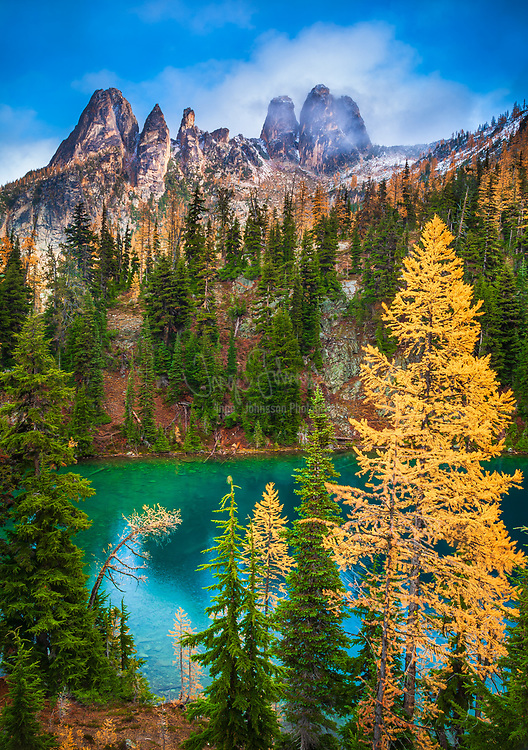 Mountain Larches at Blue Lake in North Cascades National Park, Washington.  North Cascades National Park is a U.S. National Park located in the state of Washington. The park is the largest of the three National Park Service units that comprise the North Cascades National Park Service Complex. Several national wilderness areas and British Columbia parkland adjoin the National Park. The park features rugged mountain peaks and protects portions of the North Cascades range. Nearly all of the national park is protected as the Stephen Mather Wilderness, so there are few maintained buildings and roads within the North and South units of the Park. The park is most popular with backpackers and mountain climbers. One of the most popular destinations in the park is Cascade Pass, which was used as a travel route by Native Americans. It can be accessed by a four-mile (6 km) trail at the end of a gravel road. The North and South Picket Ranges, Mount Triumph, as well as Eldorado Peak and the surrounding mountains, are popular with climbers due to glaciation and technical rock. Mount Shuksan, in the northwest corner of the park, is one of the most photographed mountains in the country and the second highest peak in the park 9,127 ft or 2,782 m.