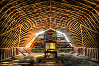 Evening sunbeams shine through the cracks of the loft in an old hay barn near Brevard, NC.