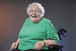 Portrait of senior woman sitting in wheelchair and laughing, Bavaria, Germany