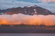 Sunset light on cloud layer around peak in Skjervoy fjord, Skjervøy municipality, Norway Ⓒ Davis Ulands | davisulands.com