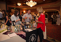 Jillian Anderson and David Grasse of Tamworth Distilling serve Dee Jakobsen their new White Mountain Ginger Root Vodka during the Winnipesaukee Wine Festival Thursday evening at Church Landing in Meredith.  (Karen Bobotas/for the Laconia Daily Sun)