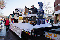 The Polar Express steams down Main Street on the Bank of New Hampshire float during the annual Holiday Parade on Saturday afternoon.  (Karen Bobotas/for the Laconia Daily Sun)