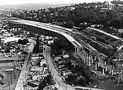 This aerial photograph shows progress of construction work on elevated portions of the Seattle Freeway east of Lake Union on Oct. 1, 1962. On the hill at right is St. Mark's Cathedral. (Paul V. Thomas / The Seattle Times)