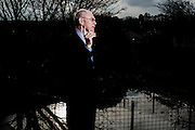 Belgium, Saint Genesius Rode, 26 February 2016. Portraits of Herman Van Rompuy, former president of the European Council, at his private home for an interview with Christoph Schmidt of Trouw NL.Portrait outside with pond.