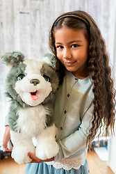 "© Licensed to London News Pictures. 14/11/2018. LONDON, UK. Ayva, aged 8, plays with Fureal Ricky the Trick Lovin' pup by Hasbro. Preview of ""DreamToys"", the official toys and games Christmas Preview, held at St Mary's church in Marylebone.  Recognised as the countdown to Christmas, the Toy Retailer's Association, an independent panel of leading UK toy retailers, have selected the definitive and most authoritative list of what toys will be the hottest property this Christmas. [Child models provided by show organisers, permission obtained to be photographed].  Photo credit: Stephen Chung/LNP"