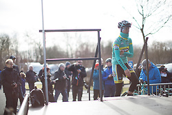 A rider from the Inpa Sottoli Giusfredi team climbs onto the sign-on podium before the start of the 2015 Omloop Het Niewsblaad race in Gent.
