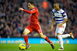 10.12.2011, Anfield Stadion, Liverpool, ENG, PL, FC Liverpool vs Queens Park Rangers, 15. Spieltag, im Bild Liverpool's Maximiliano Ruben Maxi Rodriguez in action against Queens Park Rangers' Daniel Gabbidon during the Premiership match at Anfield the football match of English premier league, 15th round, between FC Liverpool and Queens Park Rangers at Anfield Stadium, Liverpool, United Kingdom on 2011/12/10. EXPA Pictures © 2011, PhotoCredit: EXPA/ Propagandaphoto/ David Rawcliff..***** ATTENTION - OUT OF ENG, GBR, UK *****