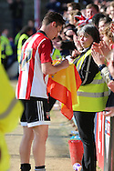 Brentford attacker, Sergi Canos (47) signing Spanish flag for fan during the Sky Bet Championship match between Brentford and Fulham at Griffin Park, London, England on 30 April 2016. Photo by Matthew Redman.