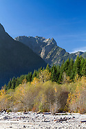 Edge Peak and some fall foliage at North Beach on Alouette Lake. Photographed from along the North Beach Trail to the mouth of Gold Creek at Alouette Lake, Golden Ears Park,  Maple Ridge, British Columbia, Canada.