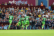 Yann M'Vila of Sunderland (21) celebrates with his teammates and manager Dick Advocaat (c) after he scores his teams 1st goal. Barclays Premier League match, Aston Villa v Sunderland at Villa Park in Birmingham, Midlands on Saturday 29th August  2015.<br /> pic by Andrew Orchard, Andrew Orchard sports photography.