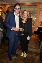 HARRY & LAURA LOPES daughter of HRH the Duchess of Cornwall at a party to celebrate the publication of 'Let's Eat meat' by Tom Parker Bowles held at Fortnum & Mason, Piccadilly, London on 21st October 2014.