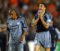 Fotball<br /> UEFA Cup Final<br /> 19.05.2004<br /> Foto: Scott Heavey, Digitalsport<br /> NORWAY ONLY<br /> <br /> Valencia v Olimpique Marseille<br /> <br /> Manuel Dos Santos (L) and Brahim Hemandi trudge off after the 2-0 defeat