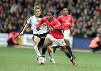 Louis Saha (Utd) Junichi Inamoto (Fulham). Fulham v Manchester United. 28/2/04. Credit : Digitalsport/Andrew Cowie.