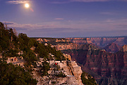 09 AUGUST 2003 -- GRAND CANYON NATIONAL PARK, AZ: A full moon rises over the south rim as seen from the north rim of the Grand Canyon from the north rim of the Grand Canyon National Park in northern Arizona.  PHOTO BY JACK KURTZ