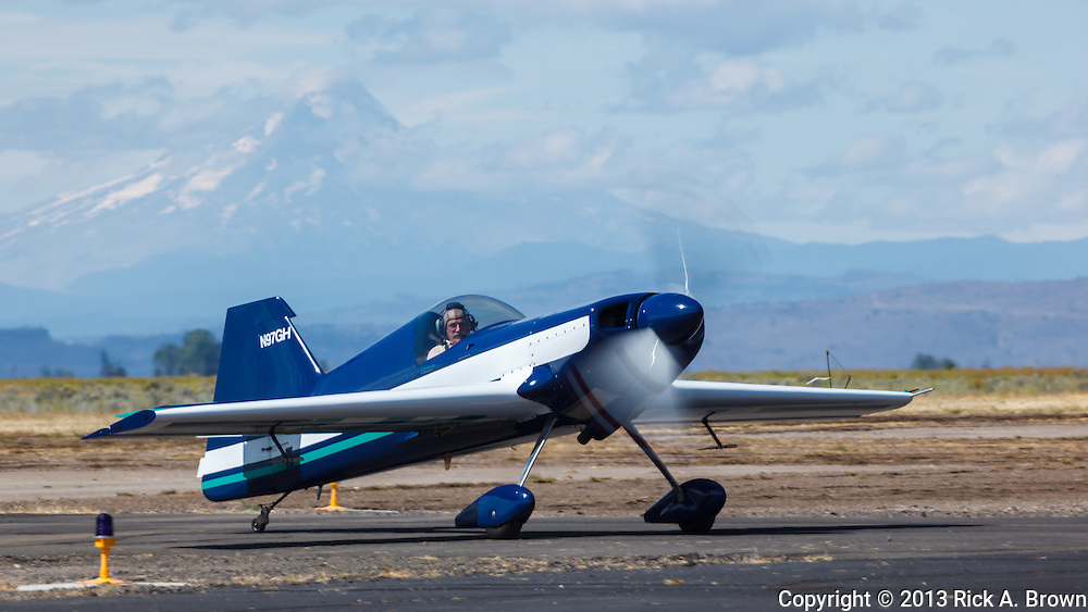 Greg Howard taxiing in his Giles 202 in front of Mt. Hood at the Airshow of the Cascades.