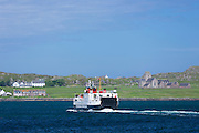 Caledonian Macbrayne - Calmac - ferry crosses Sound of Iona in Hebridean Sea from Fionnphort past Iona Abbey on Isle of Iona in the Inner Hebrides and Western Isles, West Coast of Scotland