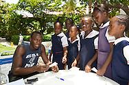Usain Bolt with schoolgirls in Kongston, Jamaica June'08