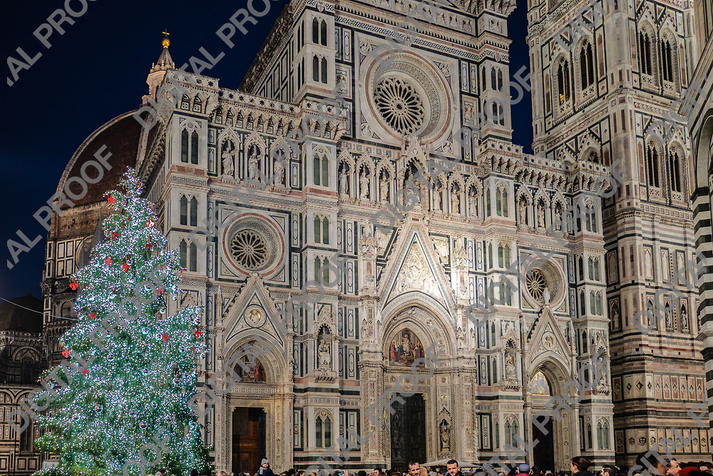 Firenze, Tuscany Italy - December 30, 2018 Detail view of the Duomo of Florence, Giotto's Bell Tower and Florence Christmas Tree at night