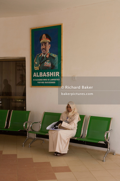 Beneath the imposing portrait of her Sudanese President in Al Fashir airport, Omar Hassan Ahmad al-Bashir, a Darfurian lady awaits the entourage of British peer Lord Ahmed of Rotheram who has brought over from the UK, a delegation to attend the first-ever international Conference on Womens' Challenge in Darfur, hosted by the govenor in his own compound.