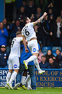 Peterborough United forward Ivan Toney (17) (hidden) celebrates with team mates and pitch invading fan  as Peterborough United forward Jamie Walker  (6) punches the air during the EFL Sky Bet League 1 match between Gillingham and Peterborough United at the MEMS Priestfield Stadium, Gillingham, England on 22 September 2018. Picture by Martin Cole