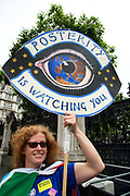 Anti Brexit protesters outside Parliament, Westminster, London as Members of Parliament debate the European Union withdrawal bill, June 20th 2018. A protester from Worcester holds an artwork of an eye and European stars and the words Posterity is watching you.