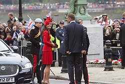 © Licensed to London News Pictures. 03/06/2012. LONDON, UK. Princes William and Harry and Kate Duchess of Cambridge arrive at the Thames to board their ship and participate in the flotilla down the river. The Royal Jubilee celebrations. Great Britain is celebrating the 60th  anniversary of the countries Monarch HRH Queen Elizabeth II accession to the throne this weekend Photo credit : Cliff Hide/ LNP