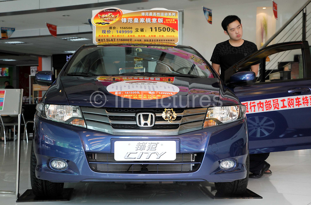 Potential buyers looks at display models at a Guangzhou Honda dealership in Shenzhen, Guangdong Province, China on 09 November 2009.