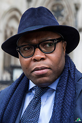 © Licensed to London News Pictures. 23/02/2018. London, UK. Lanre Haastrup speaks outside the High Court in London after judges ruled that doctors at King's College Hospital can withdraw life support for his son,11-month-old  Isaiah Haastrup, who has suffered severe brain damage. Photo credit: Rob Pinney/LNP
