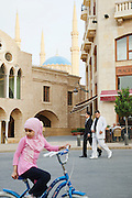 People on the streets in the busy Place d'Etoile (Nejmeh Square), nearby Saint George Orthodox Cathedral and Mohammad Al-Amin Mosque in Downtown, Beirut, Lebanon