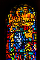 Beautiful stained glass window of Adam and Eve and lion; Debre Libanos Monastery, Oromia Region, Ethiopia.