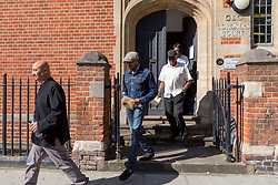 © Licensed to London News Pictures. 16/08/2017. LONDON, UK. ESA CHARLES, father of Rashan Charles with family members leave the opening of the inquest into the death of Rashan Charles at Poplar Coroner's Court in east London. Rashan Charles died after being chased by police in Dalston on 22nd July and his death sparked protests and violent clashes with police officers. No cause of death has yet been determined.  Photo credit: Vickie Flores/LNP